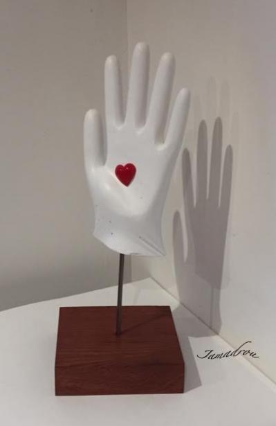 Le coeur sur la main signe